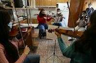 Venezuelan musicians from the Latin Vox Machine rehearse The Symphonic Little Prince in a house in Buenos Aires