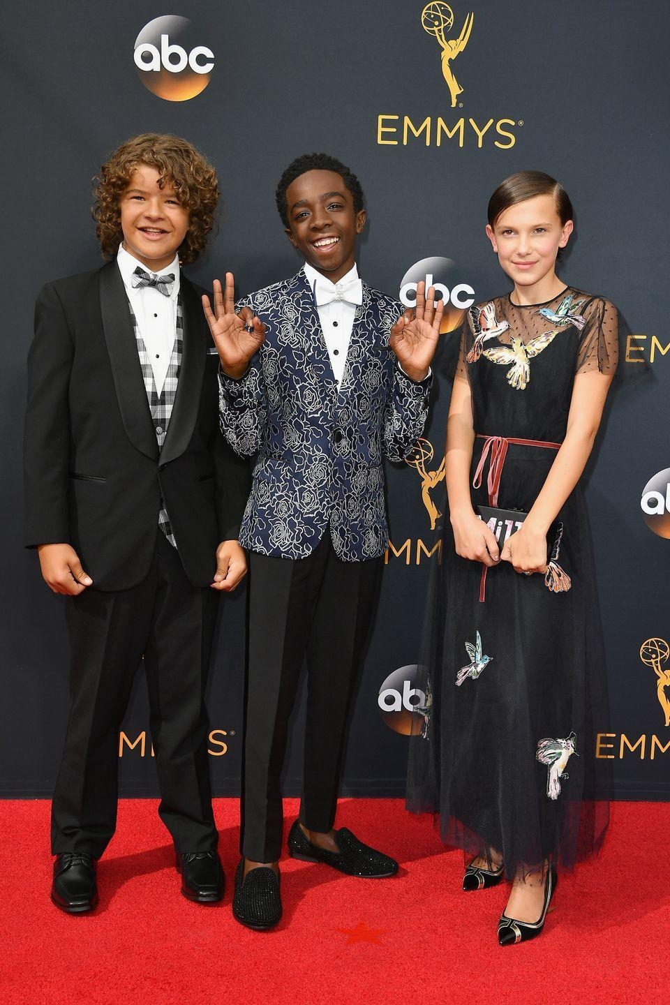 <p>For her first Emmy Awards in 2016, Millie Bobby Brown walked the red carpet with her<em> Stranger Things</em> co-stars in a tulle gown with bird appliqués. </p>