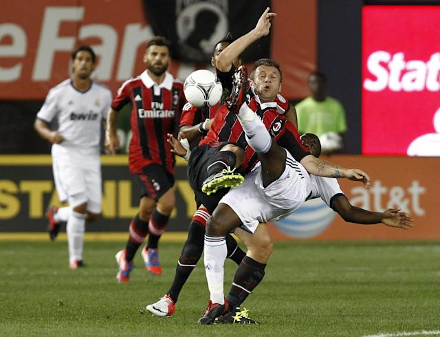 NEW YORK - AUGUST 08: Lassana Diarra #24 of Real Madrid fights for the ball with Antonio Cassano #99 of A.C. Milan during their match at Yankee Stadium on August 8, 2012 in New York City. (Photo by Jeff Zelevansky/Getty Images)