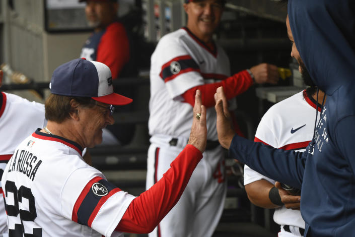 CORRECTS TO OCT. NOT AUG - Chicago White Sox manager Tony La Russa, left, high fives first baseman Jose Abreu before a baseball game against the Detroit Tigers, Sunday, Oct. 3, 2021, in Chicago. (AP Photo/Matt Marton)