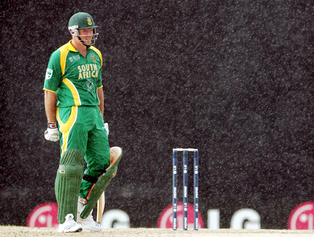 ST KITTS,  WEST INDIES - MARCH 20:  Graeme Smith in the rain after 19 overs during the Cricket World Cup Group A match between South Africa and Scotland at Warner Park on March 20, 2007, in Basseterre, St Kitts. (Photo by Duif du Toit/Gallo Images/Getty Images)