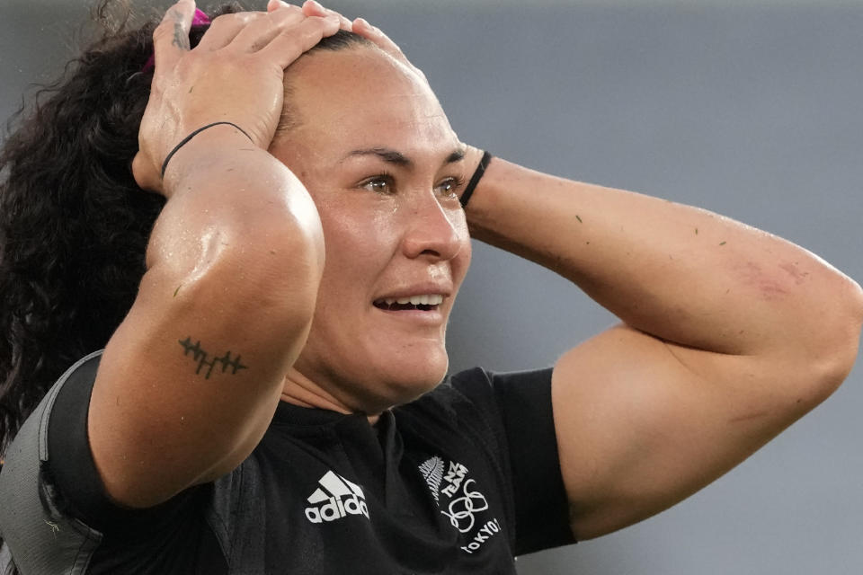 New Zealand's Portia Woodman reacts as her team celebrates defeating France in the women's rugby gold medal match at the 2020 Summer Olympics, Saturday, July 31, 2021 in Tokyo, Japan. (AP Photo/Shuji Kajiyama)