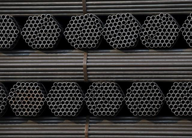 FILE PHOTO: Steel pipe products are piled at the yard of Youfa steel pipe plant in Tangshan in China's Hebei Province