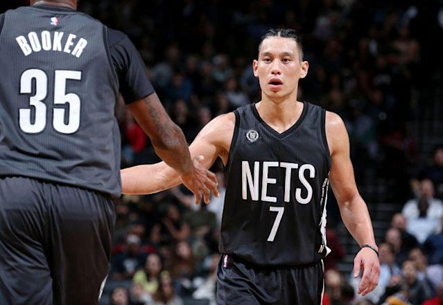 New Nets Jeremy Lin and Trevor Booker are already paying dividends. (Getty Images)