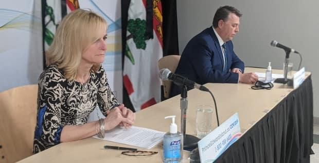 Dr. Heather Morrison and Premier Dennis King outlined tighter border controls for P.E.I. at an unscheduled briefing from Charlottetown on Monday.  (Shane Hennessey/CBC - image credit)