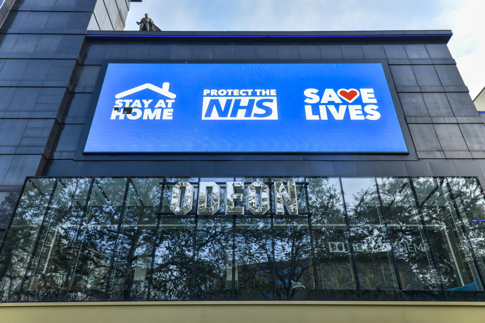 LONDON, UNITED KINGDOM - 2020/11/05: A digital display screen on the Odeon Luxe in Leicester Square showing a message saying Stay Home, Protect the NHS, Save Lives'. England has entered into the 2nd Lockdown due to the Pandemic. (Photo by Dave Rushen/SOPA Images/LightRocket via Getty Images)