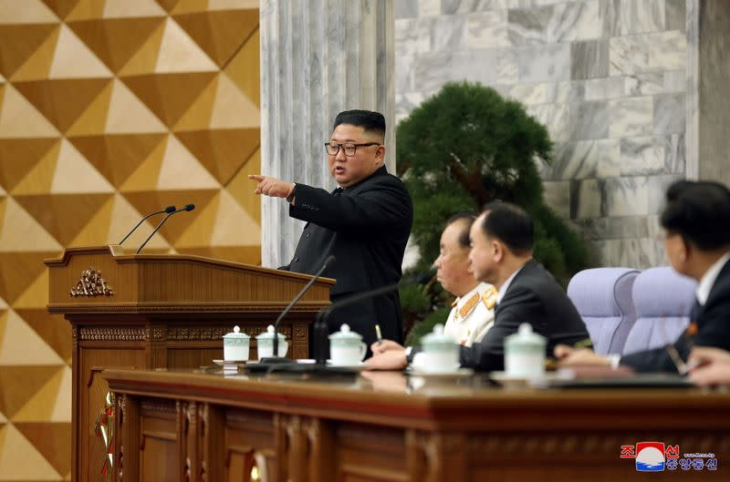 KCNA image of North Korean leader Kim Jong Un at a plenary meeting of the Workers' Party in Pyongyang