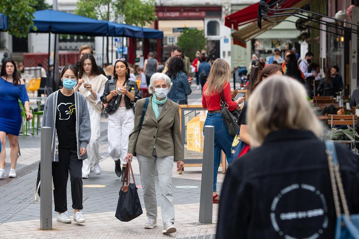 People wearing face coverings in Kensington, London. Some MPs are reportedly calling for the government to stop publishing daily COVID data. (PA)