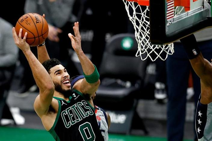 Boston's Jayson Tatum drives for the game-winning basket in the Celtics' 111-110 NBA victory over the Washington Wizards