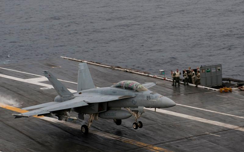 The US navy has grounded a pilot for drawing an 'obscene' image with a warplane - AFP