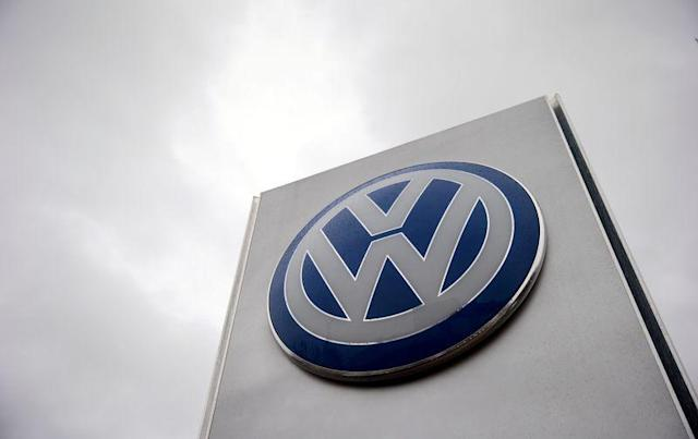 A VW sign is seen outside a Volkswagen dealership in London, Britain, November 5, 2015. REUTERS/Suzanne Plunkett/File photo
