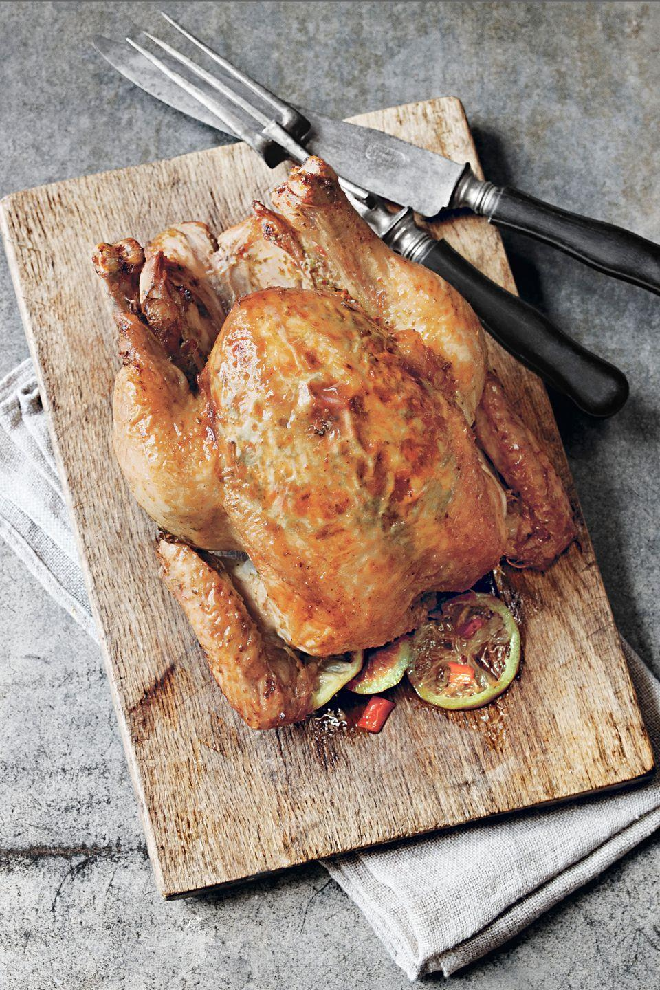 """<p>Succulent, golden-skinned chicken with cooked apples makes a memorable and mouthwatering meal.</p><p><strong><a href=""""https://www.countryliving.com/food-drinks/recipes/a1041/apple-sage-roastedchicken-panjuices-3148/"""" rel=""""nofollow noopener"""" target=""""_blank"""" data-ylk=""""slk:Get the recipe"""" class=""""link rapid-noclick-resp"""">Get the recipe</a>.</strong></p>"""