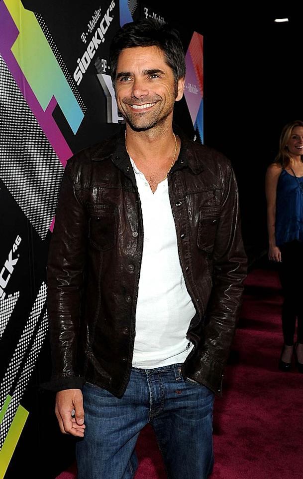 Actor John Stamos arrives at the launch party for the new T-Mobile Sidekick 4G at a Private Lot on April 20, 2011 in Beverly Hills, California. T-Mobile Celebrates the Launch of the New Sidekick 4G - Magenta Carpet Private Lot Beverly Hills, CA United States April 20, 2011 Photo by Michael Buckner/Getty Images North America To license this image (64411413), contact WireImage.com