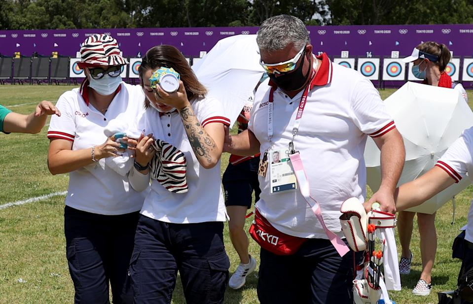TOKYO, JAPAN - JULY 23: Svetlana Gomboeva of Team ROC is treated for heat exhaustion in the Women's Individual Ranking Round during the Tokyo 2020 Olympic Games at Yumenoshima Park Archery Field on July 23, 2021 in Tokyo, Japan. (Photo by Justin Setterfield/Getty Images)