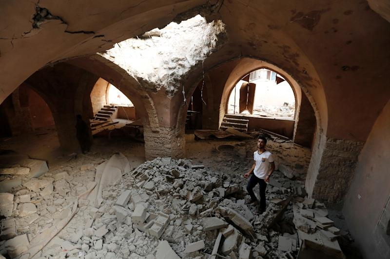 A Palestinian man inspecst heavy damage at the historical al-Omari mosque in Jabalia in the northern Gaza Strip, on August 2, 2014
