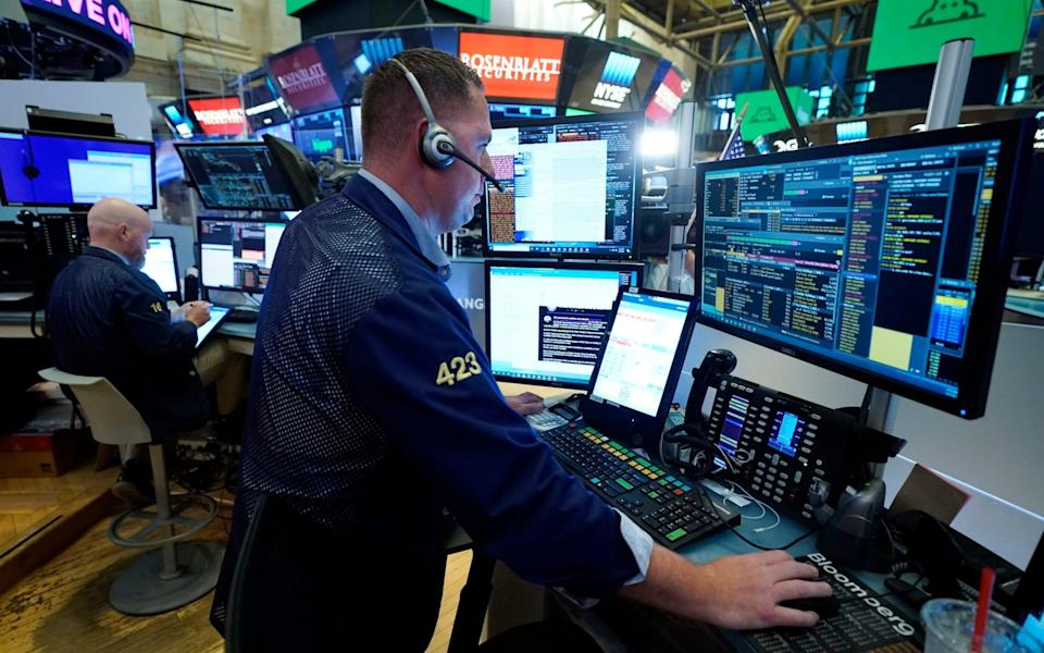 Traders remain nervous about slowing economic growth - Richard Drew/AP