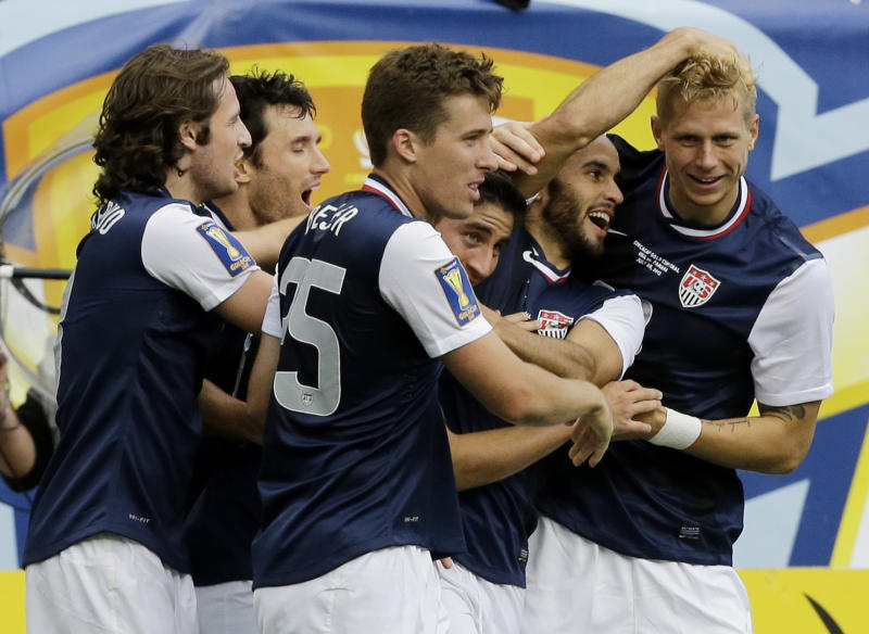 United States' Brek Shea, right, celebrates with teammates after scoring a goal during the second half of the CONCACAF Gold Cup final soccer match against Panama at Soldier Field, Sunday, July 28, 2013, in Chicago. United States won 1-0. (AP Photo/Nam Y. Huh)