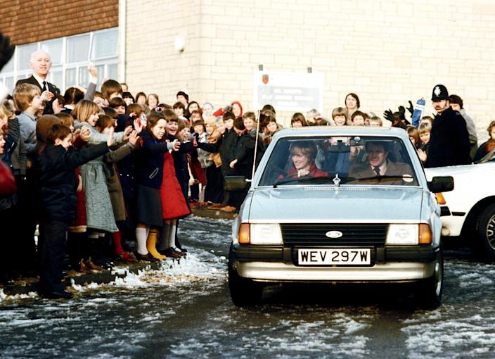 Princess Diana driving the Ford Escort with her bodyguard in the passenger seat.
