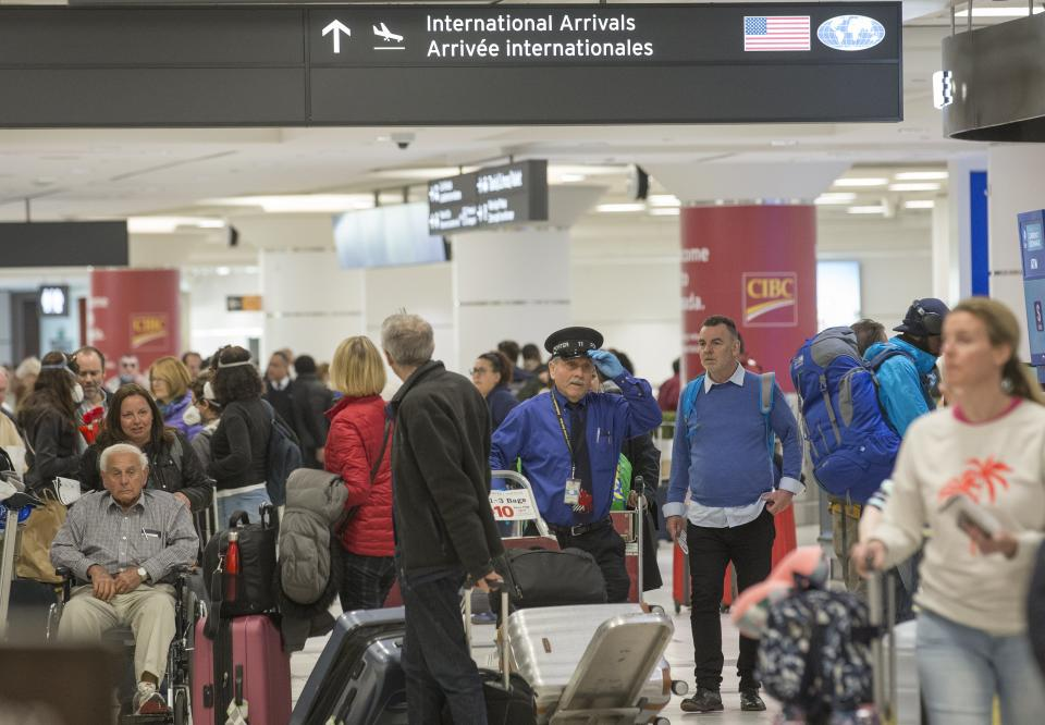 MISSISSAUGA, ON - MARCH 15: Passengers returning to Canada from international destinations make their way through Terminal 3 at Pearson International Airport.        (Rick Madonik/Toronto Star via Getty Images)