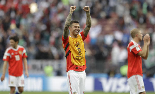 Russia's Fyodor Smolov celebrates after winning the group A match between Russia and Saudi Arabia which opens the 2018 soccer World Cup at the Luzhniki stadium in Moscow, Russia, Thursday, June 14, 2018. (AP Photo/Matthias Schrader)