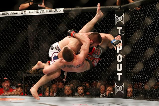"""<p>Nurmagomedov continued to slowly work his way up the ranks, but the best fighters at 155 pounds all seemed to have other things do when presented the chance to fight the rising Russian. Undaunted, Nurmagomedov started rattling off wins, including a victory over Abel Trujillo at UFC 160 in which he landed a record 21 takedowns over three rounds; and had a memorable slam of Pat Healy over the course of a one-sided decision win at UFC 165. Nurmagomedov was next linked to fights with big names Gilbert Melendez and Nate Diaz, neither of which came to fruition, which caused the Russian to comment """"If they want, I'll take them on both at once in the cage."""" </p>"""