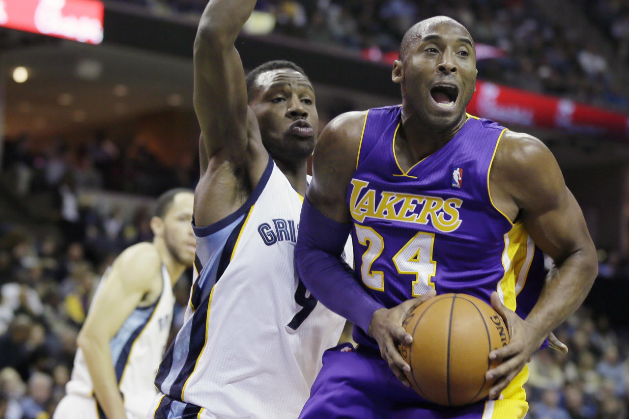 Memphis Grizzlies' Tony Allen (9) defends Los Angeles Lakers' Kobe Bryant (24) during the first half of an NBA basketball game in Memphis, Tenn., Tuesday, Dec. 17, 2013. (AP Photo/Danny Johnston)