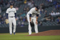 Seattle Mariners starting pitcher James Paxton, right, reacts near the mound after experiencing an injury during the second inning of a baseball game against the Chicago White Sox, Tuesday, April 6, 2021, in Seattle. Paxton left the game and the White Sox won 10-4. (AP Photo/Ted S. Warren)