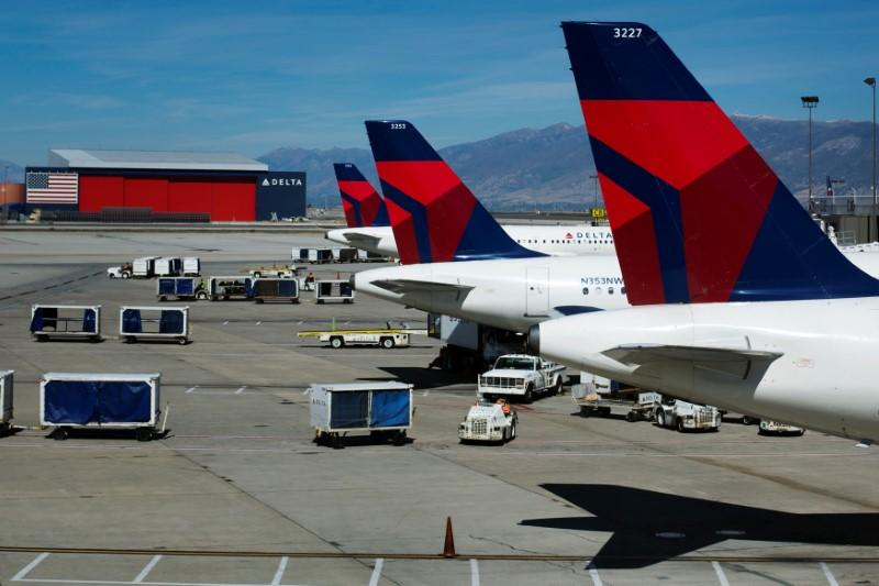Delta planes line up at their gates while on the tarmac of Salt Lake City International Airport in Utah