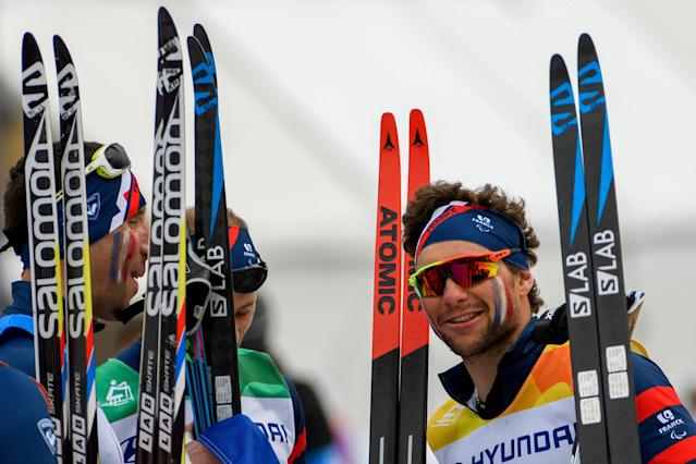 Benjamin Daviet of France (R) and teammates celebrate after France won the Cross Country Skiing 4x2.5km Open Relay at the Alpensia Biathlon Centre. The Paralympic Winter Games, PyeongChang, South Korea, Sunday 18th March 2018. OIS/IOC/Thomas Lovelock/Handout via Reuters