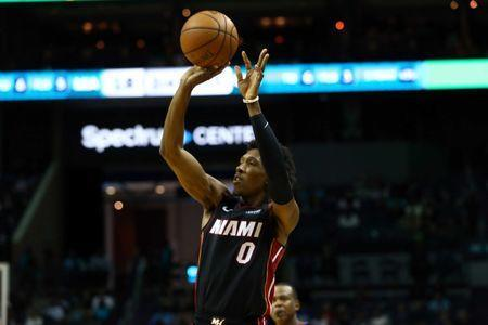 FILE PHOTO: Oct 30, 2018; Charlotte, NC, USA; Miami Heat guard Josh Richardson (0) shoots a three point basket in the first half against the Charlotte Hornets at Spectrum Center. Mandatory Credit: Jeremy Brevard-USA TODAY Sports