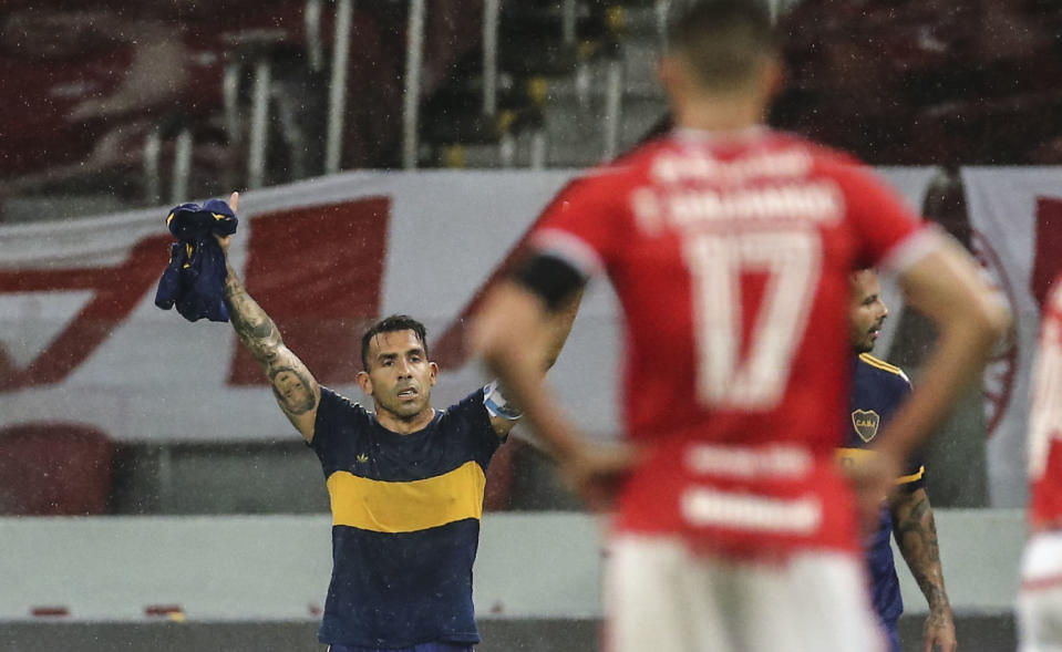 Argentina's Boca Juniors Carlos Tevez celebrates after scoring against Brazil's Internacional during their closed-door Copa Libertadores round before the quarterfinals football match at Beira Rio stadium in Porto Alegre, Brazil, on December 2, 2020. (Photo by DIEGO VARA / various sources / AFP) (Photo by DIEGO VARA/AFP via Getty Images)