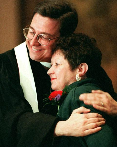 FILE - In this Sunday, Jan. 21, 1996 file photo, Norma McCorvey, Jane Roe in the 1973 Roe v. Wade decision, is embraced by The Rev. Robert L. Schenck of the National Clergy Council before she addresses a memorial service at Georgetown University in Washington. McCorvey, in town to join abortion opponents for their annual protest march, shocked abortion rights advocates in 1995 by announcing that she opposes the procedure. (AP Photo/Cameron Craig, File)