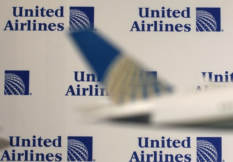 Logos are pictured on a wall before a news conference announcing the merger between Continental Airlines and United Airlines in New York