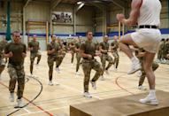 """<p><strong>You'll need: Floor space</strong></p><p>We've recruited Tom Frearson, ex-Royal Marine and head coach at <a href=""""http://www.befearsome.com/"""" rel=""""nofollow noopener"""" target=""""_blank"""" data-ylk=""""slk:BeFearsome"""" class=""""link rapid-noclick-resp"""">BeFearsome</a>, to rustle up his go-to workout for staying fit at home with little or no kit. """"A key component of being a <a href=""""https://www.menshealth.com/uk/fitness/a31154050/aldo-kane/"""" rel=""""nofollow noopener"""" target=""""_blank"""" data-ylk=""""slk:Royal Marine Commando"""" class=""""link rapid-noclick-resp"""">Royal Marine Commando</a> is fitness. In training, from day one week one, it's the first and last thing you think about every single day... It doesn't just change your body, it changes your mind, too. This workout can be completed anywhere, anytime, with little or no equipment. It works on functional and <a href=""""https://www.menshealth.com/uk/bodyweight-exercises/"""" rel=""""nofollow noopener"""" target=""""_blank"""" data-ylk=""""slk:bodyweight"""" class=""""link rapid-noclick-resp"""">bodyweight</a> fitness, the bread and butter for commandos."""" You heard the man. Working through five total sets, you'll start increasing your reps from the first set through to the third. Once you hit the fourth set, the reps will begin decreasing — but you'll be required to maintain the same consistency that you had at the beginning of the workout. Below, you'll see examples of each move, but if you fancy making it harder, just grab a <a href=""""https://www.menshealth.com/uk/building-muscle/a758657/the-7-best-kettlebell-exercises-to-build-muscle/"""" rel=""""nofollow noopener"""" target=""""_blank"""" data-ylk=""""slk:kettlebell"""" class=""""link rapid-noclick-resp"""">kettlebell</a>, <a href=""""https://www.menshealth.com/uk/building-muscle/a755117/the-10-best-dumbbell-exercises/"""" rel=""""nofollow noopener"""" target=""""_blank"""" data-ylk=""""slk:dumbbell"""" class=""""link rapid-noclick-resp"""">dumbbell</a> or heavy backpack. We'll let you decide on that one. Go well.</p><p><strong>Set 1</strong></p><p>6 chest to grou"""