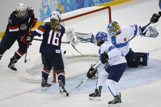 Kelli Stack of the Untied States (16) scores a goal on an assist from Hilary Knight (21) of the Untied States as Goalkeeper Noora Raty of Finland tries to block the shot during the second period of the 2014 Winter Olympics women's ice hockey match at Shayba Arena, Saturday, Feb. 8, 2014, in Sochi, Russia. (AP Photo/David J. Phillip)