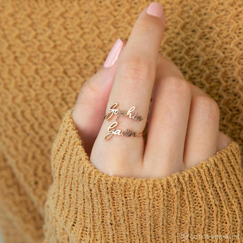 <p>Bring two people you love together (that can also be you and your partner) with this unique <span>Caitlyn Minimalist Double Name Ring</span> ($24, originally $32).</p>