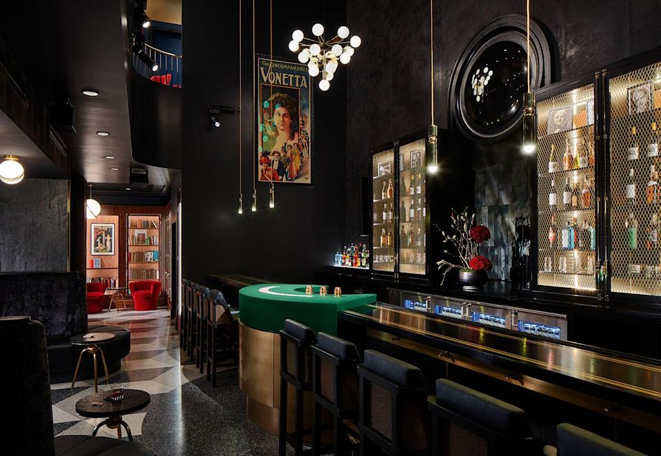"""<p><em>Chicago, IL</em></p><p>The bartenders behind the counter at <a href=""""https://www.chicagomagiclounge.com/welcome"""" rel=""""nofollow noopener"""" target=""""_blank"""" data-ylk=""""slk:Magic Lounge"""" class=""""link rapid-noclick-resp"""">Magic Lounge</a> are anything but ordinary. Sure, they'll pour you a drink, but they will also perform a trick or two that will entertain and challenge your mind. The venue also provides full-blown magic shows, magic lessons, and—oh, yeah—you have to enter through a laundromat. </p><p>Photo: <a href=""""https://www.chicagomagiclounge.com/inside-the-venue"""" rel=""""nofollow noopener"""" target=""""_blank"""" data-ylk=""""slk:Steve Hall"""" class=""""link rapid-noclick-resp"""">Steve Hall</a></p>"""