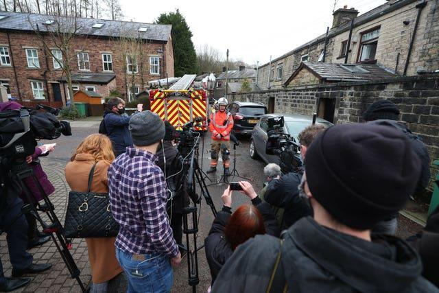 Incident commander, Watch Manager Steve Wilcock, centre, from Greater Manchester Fire and Rescue Service, gives a media briefing in Ramsbottom, Bury, Greater Manchester