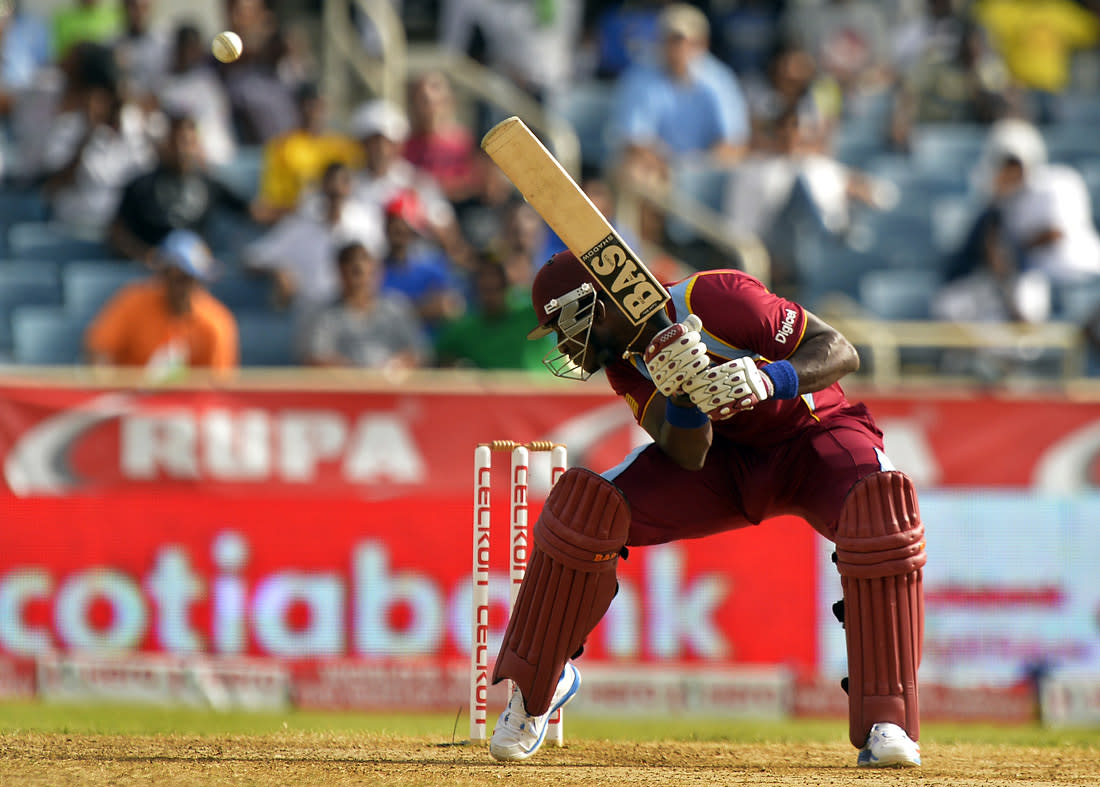 West Indies cricketer Darren Sammy ducks to avoid a bouncer off Indian bowler Umesh Yadav during the second match of the Tri-Nation series between Indian and West Indies at the Sabina Park stadium in Kingston on June 30, 2013. India have scored 229/7 at the end of their innings.   AFP PHOTO/Jewel Samad        (Photo credit should read JEWEL SAMAD/AFP/Getty Images)