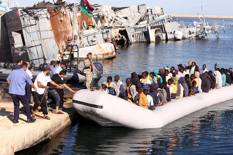 Migrants were shuttled in a three-hour operation to a naval base in Tripoli on September 29, 2015, before being transferred to reception centres (AFP Photo/Mahmud Turkia)