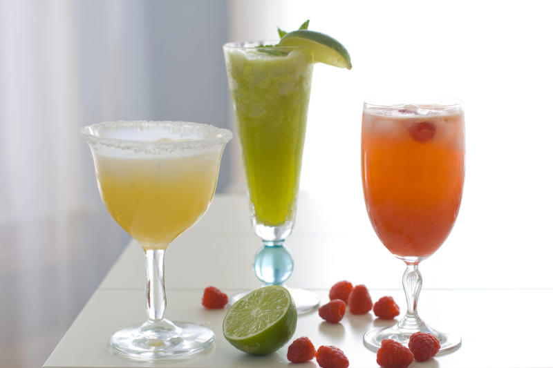 This April 2, 2012, photo made in Concord, N.H., shows three cocktails for a Cinco de Mayo celebration. (AP Photo/Matthew Mead)
