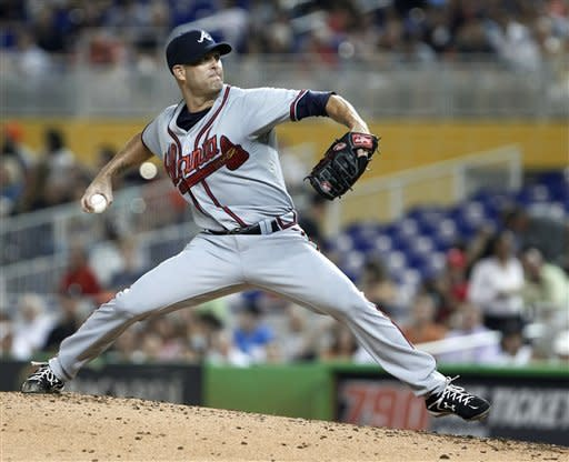 Atlanta Braves' Tim Hudson delivers a pitch during the second inning of a baseball game against the Miami Marlins, Tuesday, July 24, 2012, in Miami. (AP Photo/Wilfredo Lee)