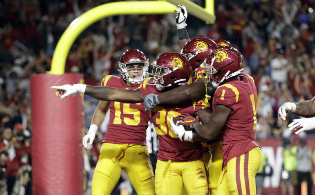Southern California running back Markese Stepp, second from left, points after rushing for a touchdown against Utah during the second half of an NCAA college football game Friday, Sept. 20, 2019, in Los Angeles. (AP Photo/Marcio Jose Sanchez)