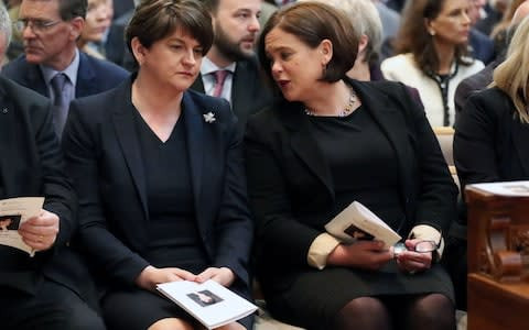 DUP leader Arlene Foster and Sinn Fein leader Mary-Lou McDonald sat next to one another at the funeral - Credit: Kelvin Boyes/Press Eye