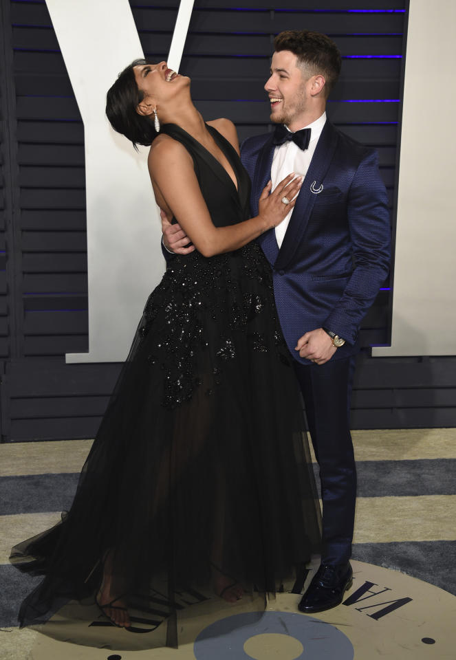 Priyanka Chopra, left, and Nick Jonas arrive at the Vanity Fair Oscar Party on Sunday, Feb. 24, 2019, in Beverly Hills, Calif. (Photo by Evan Agostini/Invision/AP)