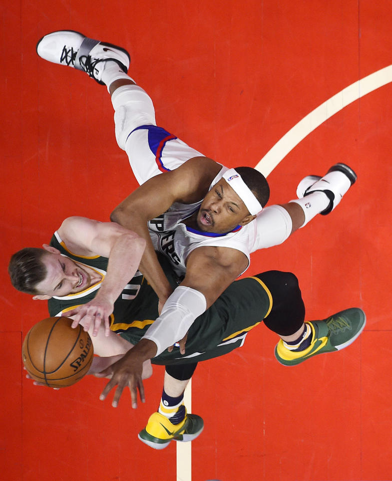 <p>Utah Jazz forward Gordon Hayward, left, shoots as Los Angeles Clippers forward Paul Pierce defends during the first half in Game 7 of an NBA basketball first-round playoff series, Sunday, April 30, 2017, in Los Angeles. (Photo: Mark J. Terrill/AP) </p>