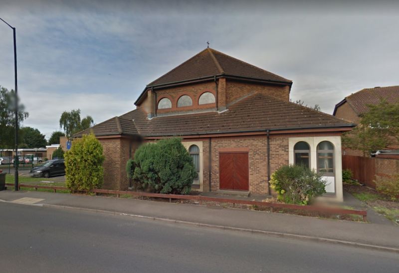 The woman has been attending funerals at the Holy Redeemer Church in Slough, Berkshire (Picture: Google)