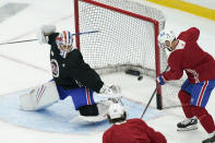 Montreal Canadiens left wing Tomas Tatar (90) shoots while goaltender Charlie Lindgren defends during practice for the NHL hockey Stanley Cup finals in Tampa, Fla., Tuesday, June 29, 2021. (AP Photo/Gerry Broome)