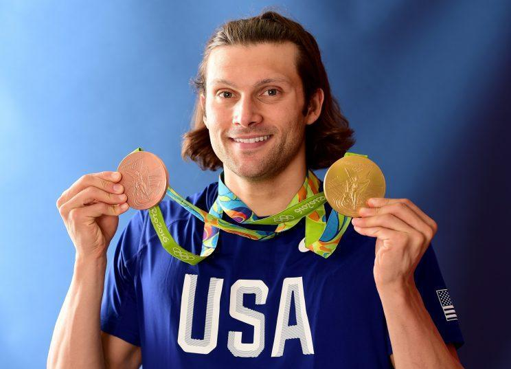 Cody Miller poses for a photo after winning a bronze and a gold medal at the Olympic Games. (Getty)