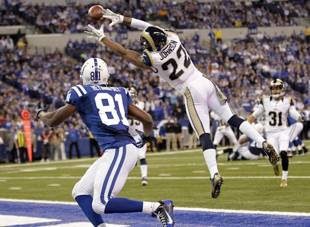 St. Louis Rams cornerback Trumaine Johnson, (22) intercepts a pass intended for Indianapolis Colts wide receiver Darrius Heyward-Bey during the second half of an NFL football game in Indianapolis, Sunday, Nov. 10, 2013. (AP Photo/AJ Mast)